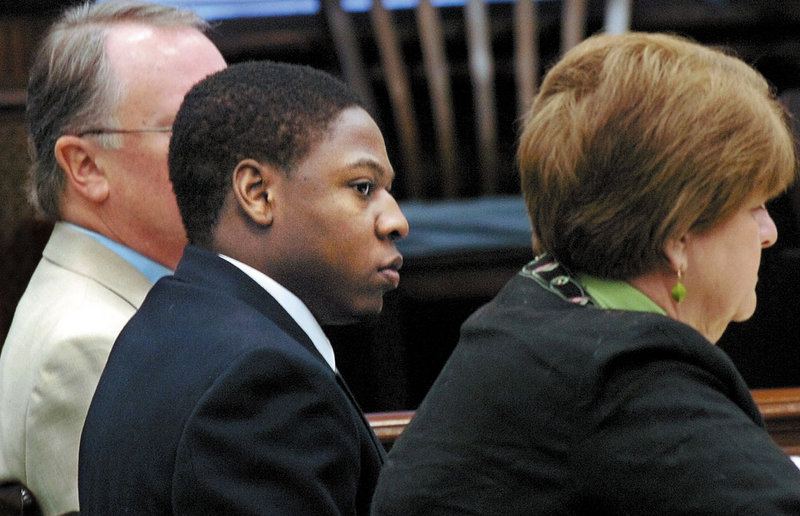 Defendant Daniel L. Fortune sits between his attorneys Robert Ringer, left, and Pamela Ames, right, during his trial Thursday at the Somerset County Superior Court in Skowhegan. Fortune faces 14 charges relating to a machete attack on William Guerrette Jr. and his daughter Nicole in the spring of 2008.