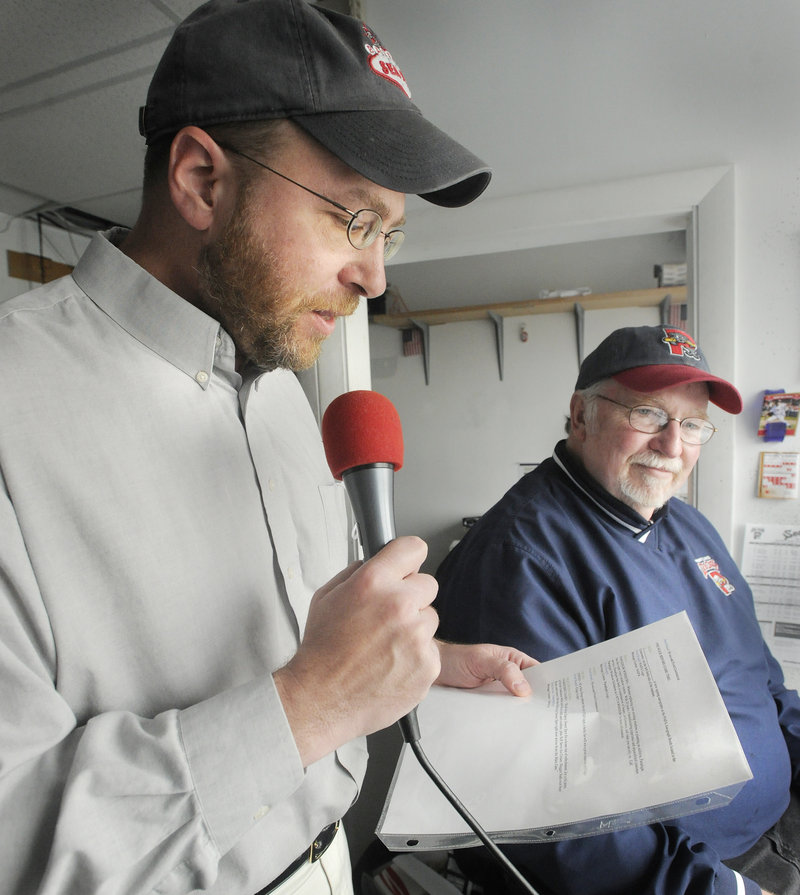 Reporter Ray Routhier tries out the job of public address announcer for a Portland Sea Dogs game at Hadlock Field with veteran announcer Dean Rogers.