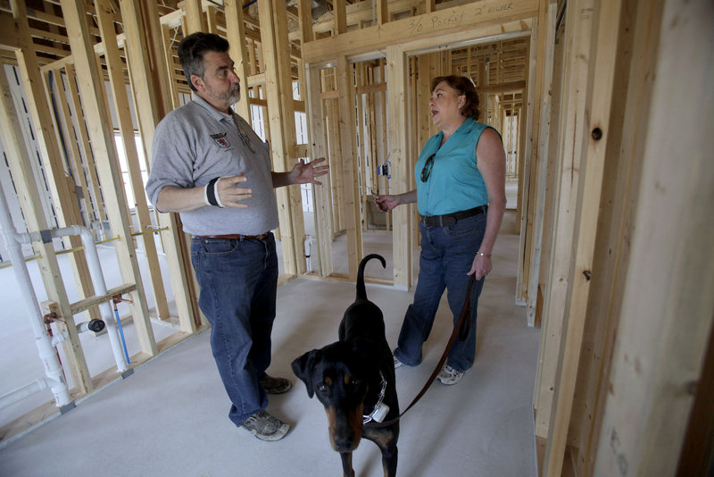 Dave Hamilton of Excalibur Builders in Slinger, Wis., discusses the progress of new-home construction with homeowner Eva Lehman. Lehman and her husband, Daryl, had a difficult time securing financing for their green-built home due to the lack of comparable sales in the area, a necessary and scrutinized portion of real estate appraisals.