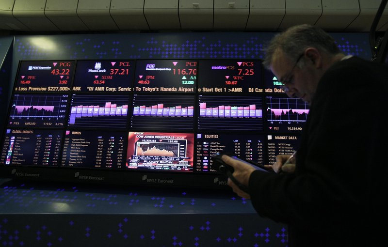 A trader works on his handheld device from the floor of the New York Stock Exchange on Friday as stocks continued to fall. The biggest U.S. fund managers say the recent bull market should weather Europe's widening debt crisis.