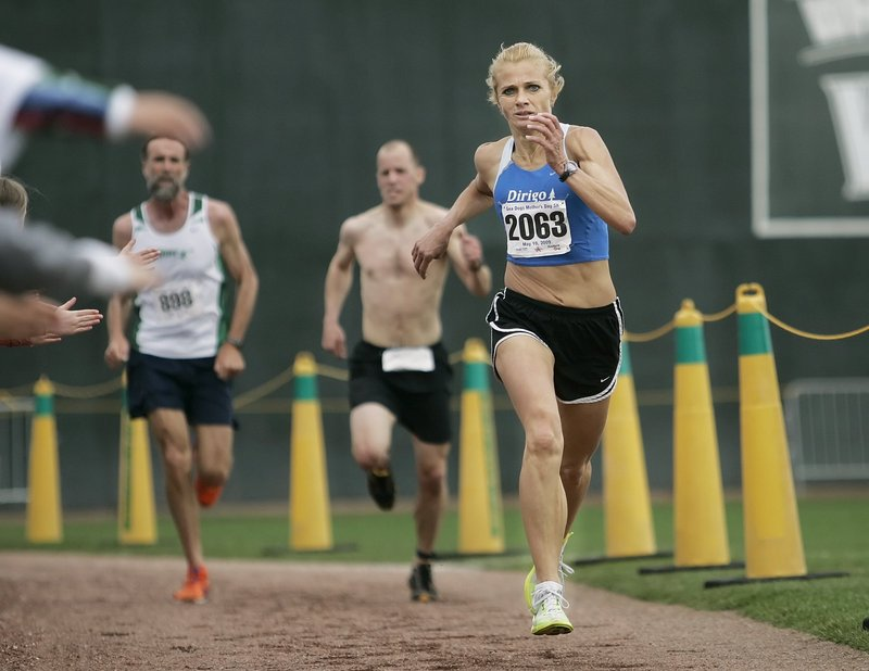 Christine Reaser of Dayton returns to defend her women's championship in the Sea Dogs Mother's Day 5K.