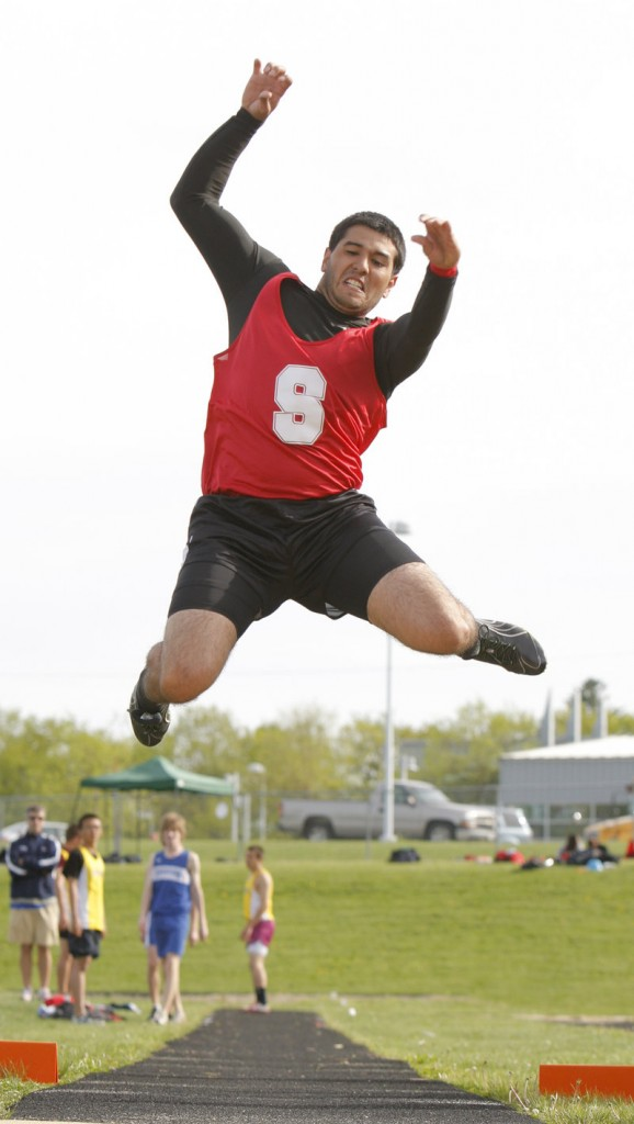 Kyle McNeil of Sanford has time to admire the Westbrook scenery while sailing in the long jump. His longest jump was 18 feet, 21⁄2 inches.
