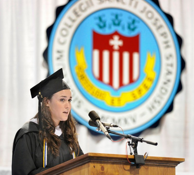Valedictorian Allison Zellers of Concord, N.H., speaks during the Saint Joseph's College graduation in Standish on Saturday.