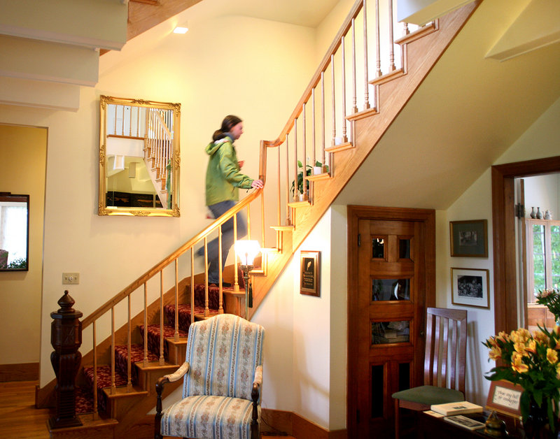 Leah Ingraham of Rockport walks up the grand staircase at the Hawthorn Inn.