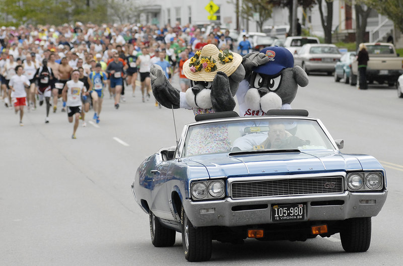 Sea Dogs mascot Slugger and his mom lead the way in the pace car at the start of the 10th annual Sea Dogs Mother's Day 5K on Park Avenue in Portland on Sunday. Race proceeds benefit breast cancer research, and many of the runners ran to honor loved ones who died of the disease.