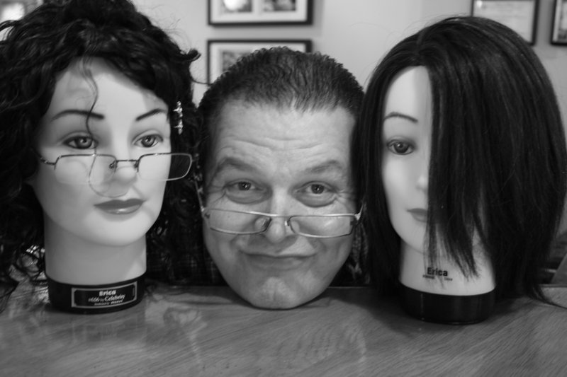 """Robert Towle clearly had a vibrant sense of humor, as evidenced in this photo at Amore Styles in Portland. He was gifted in the art of hair styling, and truly enjoyed that his styling skills helped women to feel """"fabulous"""" about themselves, his family said."""