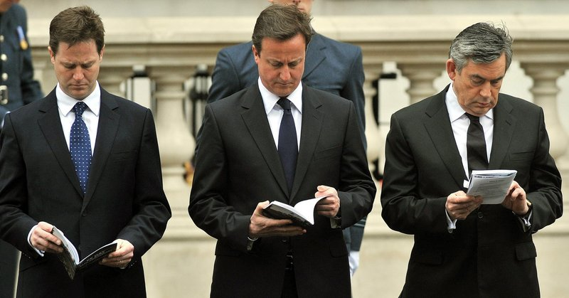 Gordon Brown, right, Britain's prime minister and leader of the Labour Party, Liberal Democrat Party leader Nick Clegg, left, and Conservative Party leader David Cameron attend a VE Day service in London on Saturday. The Conservative Party fell 20 votes short of a majority on Thursday.