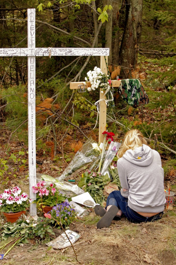 Scarborough High senior Brittany Hershberger grieves at the site of the car crash in Scarborough that killed senior Steven Delano and injured three other teenagers Saturday night.