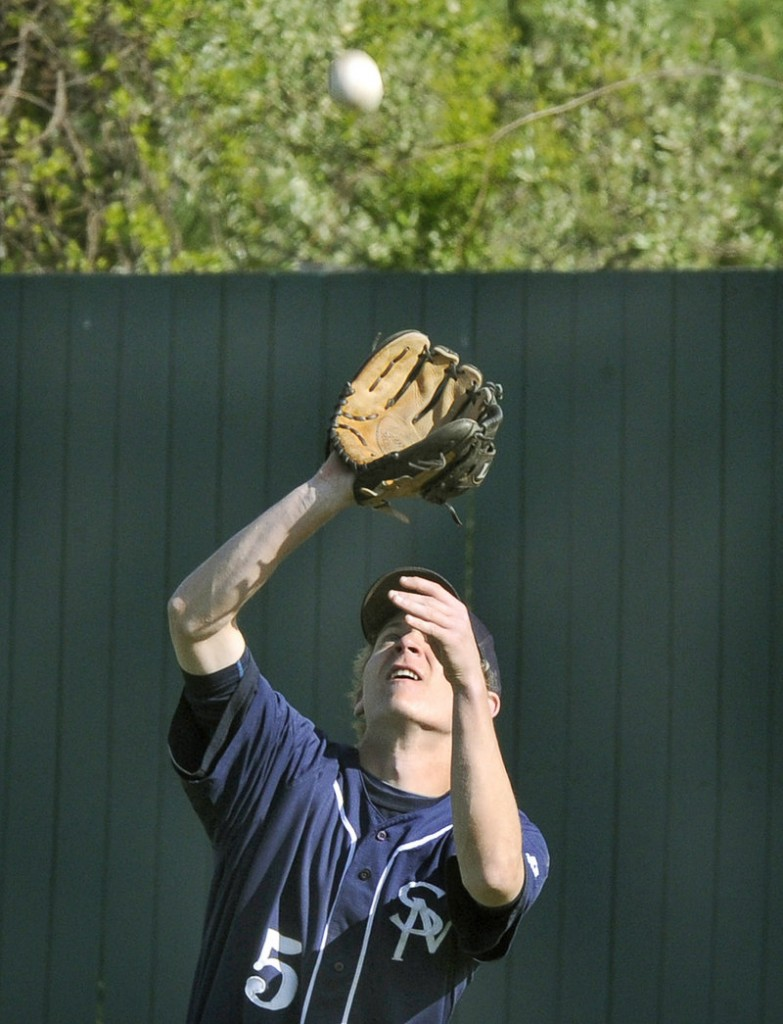 SMCC outfielder C.J. Giles shields his eyes and makes a catch Monday during his team's 5-3 win over Penn State-Greater Allegheny.
