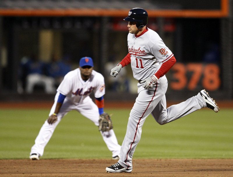 Ryan Zimmerman of the Nationals trots past Mets second baseman Luis Castillo after hitting a third-inning solo home run in Monday night's 3-2 win at New York.