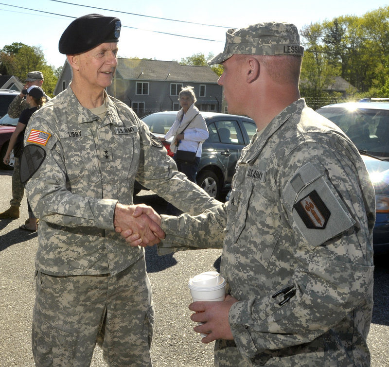 Maj. Gen. John Libby, state adjutant general, shakes hands with Sgt. Cory Lessard May 5 at a send-off for Lessard's Reserve unit, which is headed for Iraq.