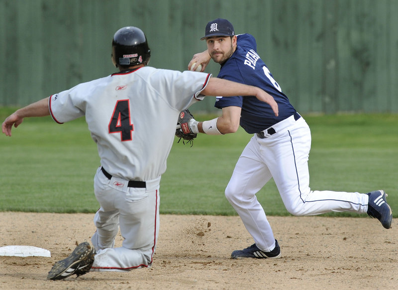 John Patriquin/Staff Photographer University of Maine shortstop Tony Patane avoids Northeastern's Frank Compagnone and throws to first base to complete a double play during a baseball game Tuesday at Goodall Park in Sanford. Maine overcame a 2-1 deficit and pulled away for an 8-3 victory.