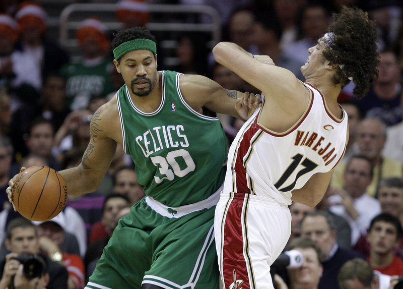 Rasheed Wallace of the Boston Celtics attempts to gain room Tuesday night while guarded by Anderson Varejao of the Cleveland Cavaliers. Boston won, 120-88.