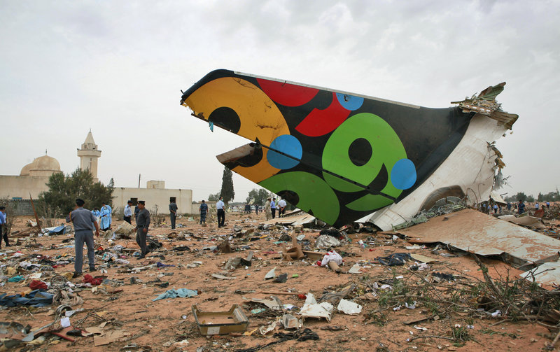 Rescue teams search through debris after an Afriqiyah Airways jetliner crashed Wednesday on approach to the international airport in Tripoli, Libya, killing 103 people on board.