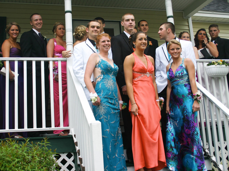 Standing at the front of the crowd of well-dressed South Portland High School prom-goers last Saturday, Karleigh Bradbury, Alexis Bogdanovich and Danielle Dibiase wear gowns that show the popularity of embellishments, bright colors and printed fabrics.