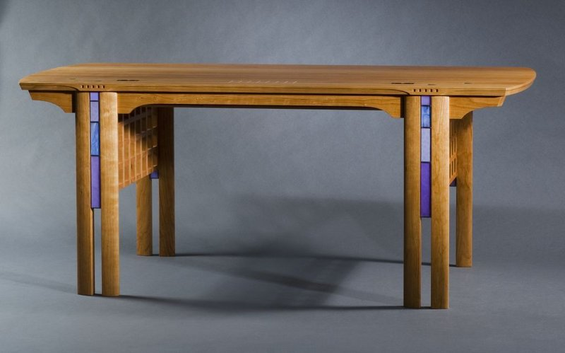 Furniture maker Kevin Rodel describes his style as International Arts and Crafts. The Brunswick craftsman's studio will be open by appointment to the public through early June. Pictured is Rodel's Glasgow Desk in cherry.