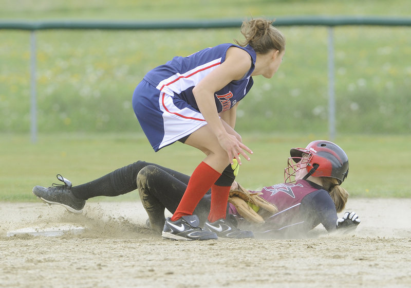 Katie Whittum of Greely slides safely into second with a stolen base Wednesday as shortstop Rachel Edson of Gray-New Gloucester applies the tag. Greely, which had been scrambling for a Western Class B tournament spot, earned a 9-7 victory at home.
