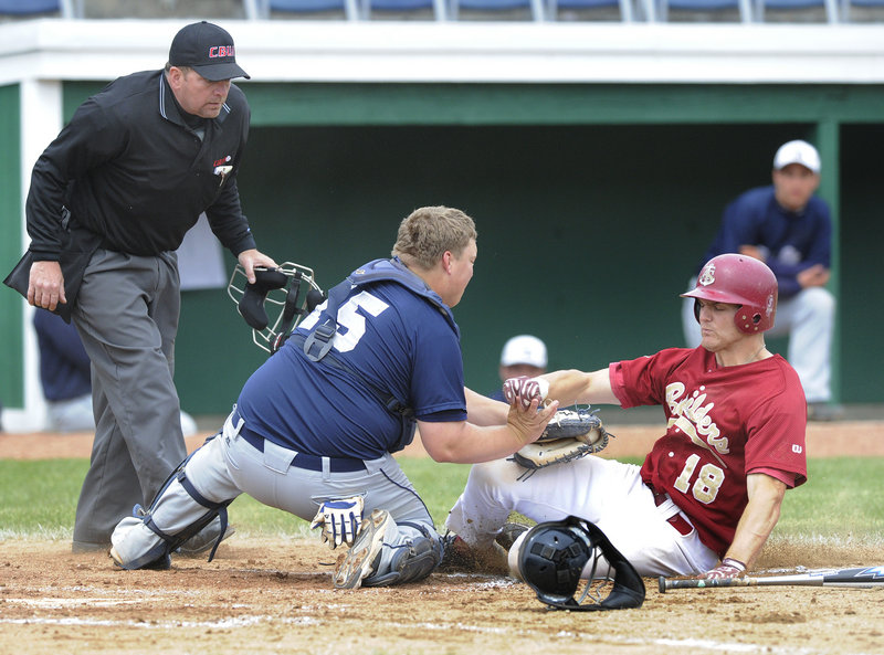 Penn State Greater Allegheny catcher Josh Kubisz tags out Andrew Yonta of the Apprentice School trying to score on a ground ball during a game in the USCAA baseball tournament Wednesday at The Ballpark in Old Orchard Beach.Photos by John Ewing/Staff Photographer