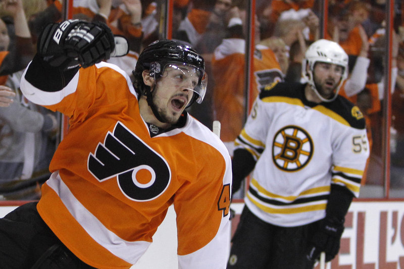 Danny Briere celebrates in front of Boston's Johnny Boychuk after giving the Flyers a 2-0 lead with a second-period goal.