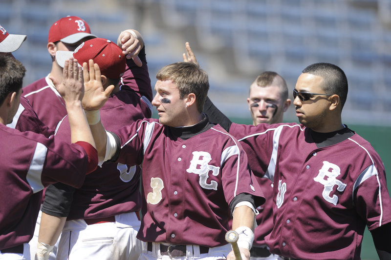 Reggie Smith, 3, celebrates with teammates Thursday after scoring for Briarcliffe, which beat Cincinnati Clermont in the USCAA final as baseball returned to The Barkpark in OOB.