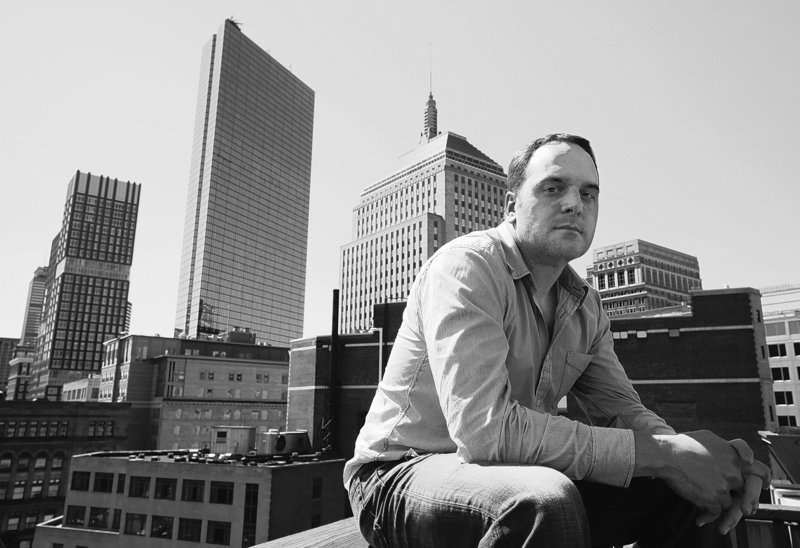 Erik Proulx, a former advertising copywriter, is seen on the roof of an office building where he maintains an office in Boston. Proulx says he no longer wants to rejoin an industry he thinks will continue to struggle.