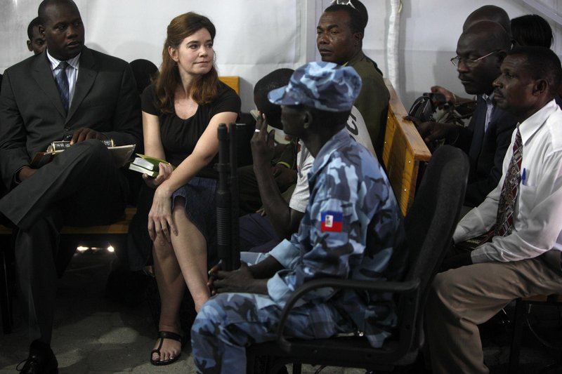 U.S. missionary Laura Silsby, second from left, sits during an audience at a courthouse in Port-au-Prince Thursday. Silsby, on trial for trying to remove 33 children from Haiti following the devastating Jan. 12 earthquake, knew her efforts were illegal, a prosecutor said.