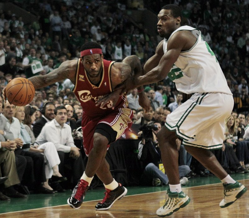 Tony Allen of the Celtics, right, tries to disrupt LeBron James' drive to the basket Thursday in Game 6 of the Eastern Conference semifinals. Boston won 94-85 to eliminate the Cavaliers and advance to face Orlando in the finals.