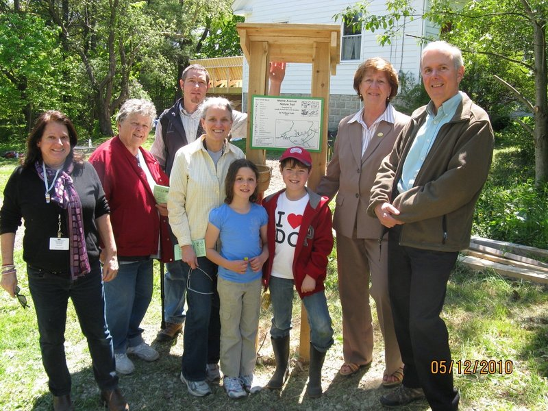 Maine Avenue Trail Workers include, from left, Lyseth teacher Margaret Slocumb, grandmother Katherine Shepard, father Gene McKeen, Lyseth teacher Pat Riley, second-graders Emily McKeen and Aidan Reid, city councilor and representative on the Landbank Commission Cheryl Leeman and Landbank Commission Chairman Tom Jewell.