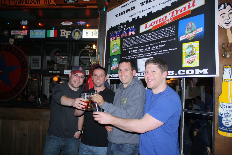 The PortlandTaps.com founders raise brew glasses with the traveling Long Trail representative recently. From left are Cory Cronk, Long Trail's Steve Kierstead, Josh Baston and Caleb O'Connell.