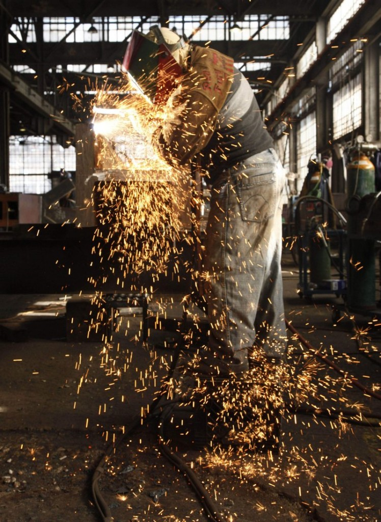 A steelworker at MRP in South Plainfield, N.J., fabricates a steel beam. Industrial production in the United States logged a stronger-than-expected gain in April.