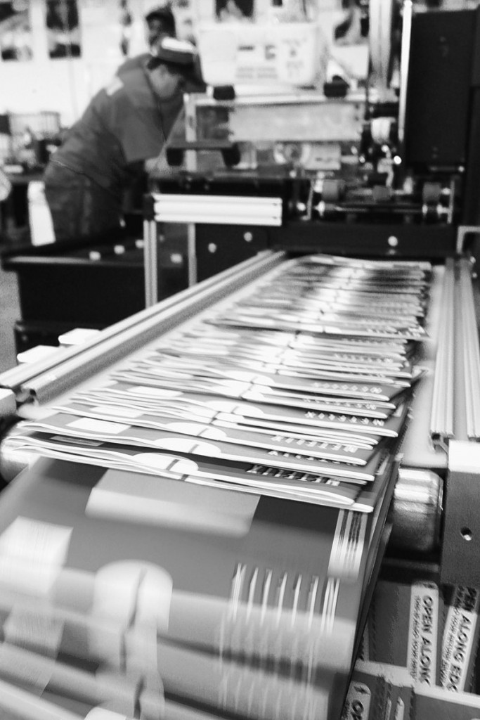 A worker operates a machine that stuffs DVDs into mailing envelopes at the Netflix distribution center in Orlando, Fla. As Netflix has grown, brick-and-mortar video stores have sunk from 26,000 in 2002 to a projected 5,000 in 2014.