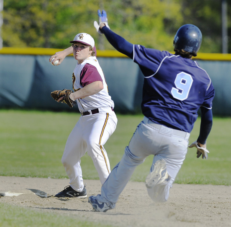 Cape Elizabeth second baseman Kyle Piscopo sets to throw to first and complete a double play Friday after forcing Chris Cole of York in the second inning.