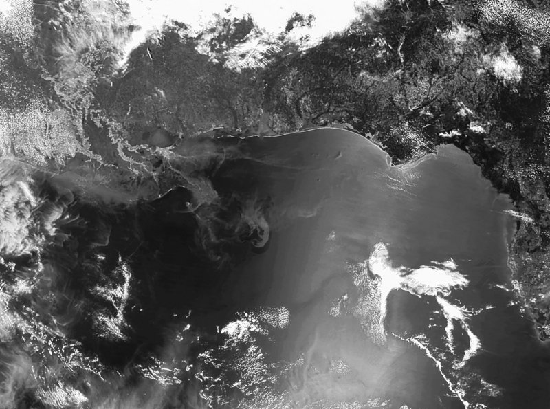 A satellite image provided by NOAA shows a clearly defined oil slick in the Gulf of Mexico on Monday. The blown-out well from the explosion of the Deepwater Horizon oil rig has by most estimates pumped out at least 4 million gallons of crude so far.