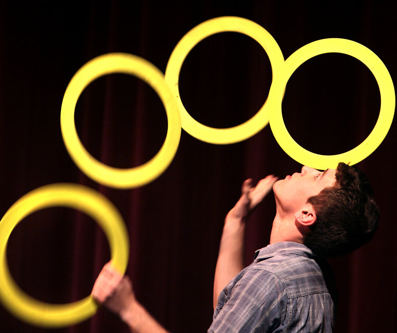 Shane Miclon of Buckfield juggles up to seven rings during the circus arts performances.