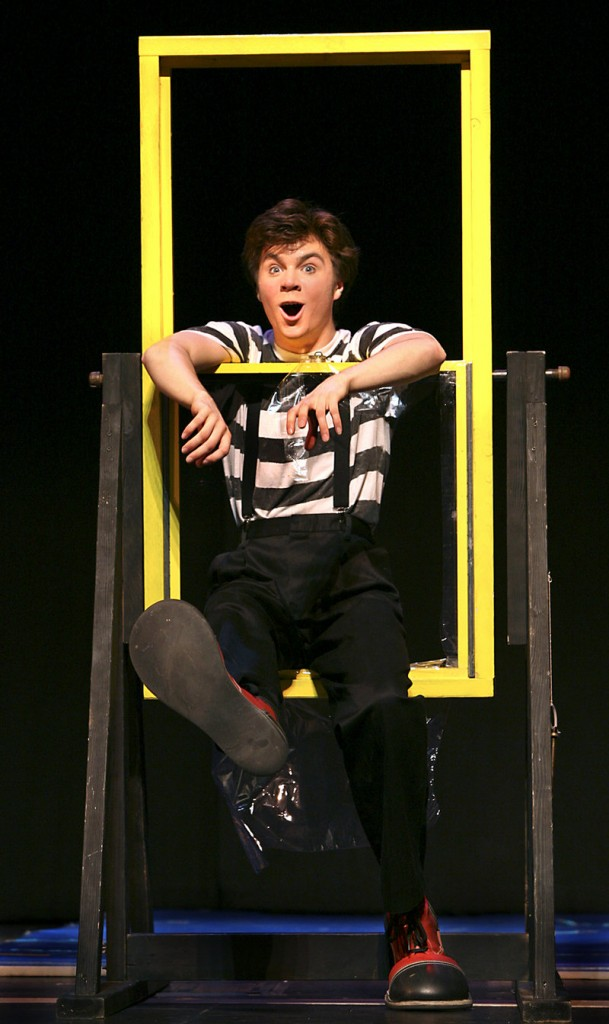 Jared Mongeau of Cumberland performs a clown skit in which he attempts to climb through a window to get a bag of money.