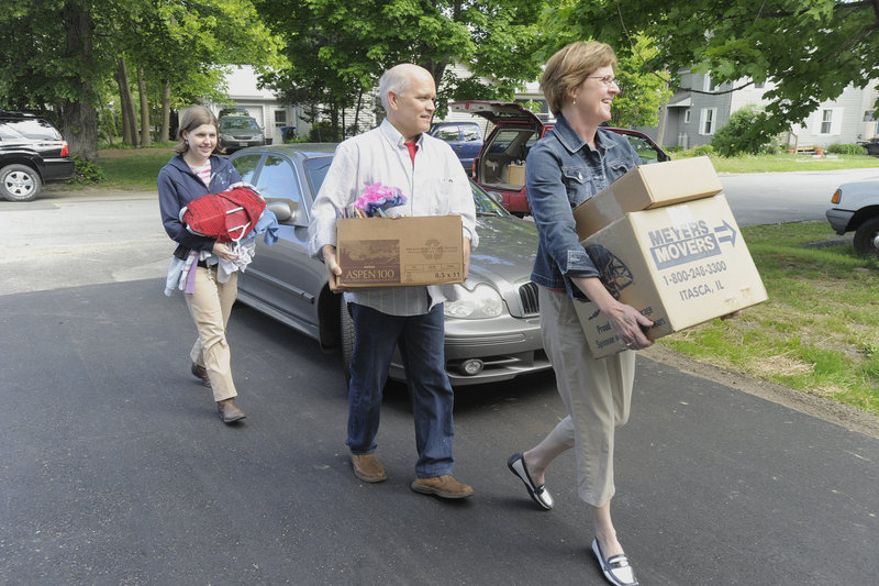 Anna Bulger, left, gets some help with her belongings Saturday from her parents Mary Chris and Paul Bulger. Anna and seven others this weekend are moving into a nine-bedroom, renovated home in South Portland.