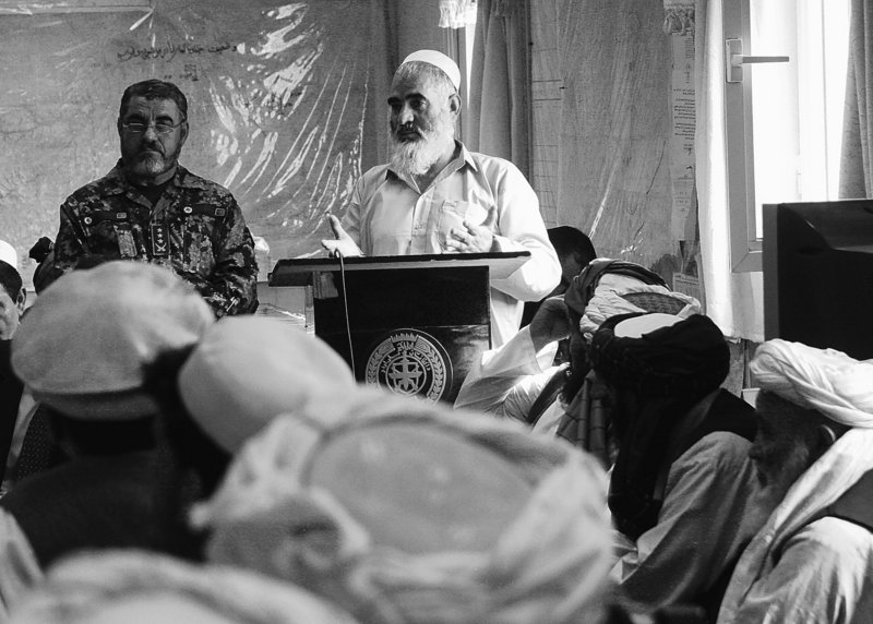 Haji Gulam Farouk, who said he spent three years in American prisons, speaks at a special release ceremony allowing him and 10 other Afghan detainees to return home on Saturday.