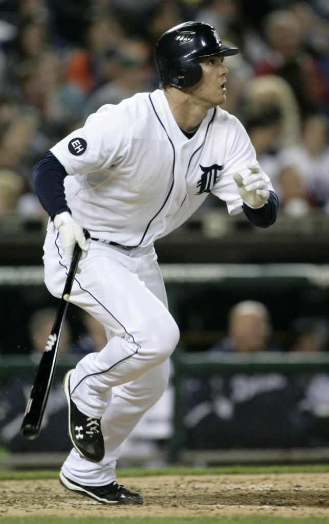 Brennan Boesch of the Detroit Tigers watches his two-run triple sail to center field in the sixth inning Saturday night. The Tigers rallied to beat the Red Sox in 12 innings, 7-6.