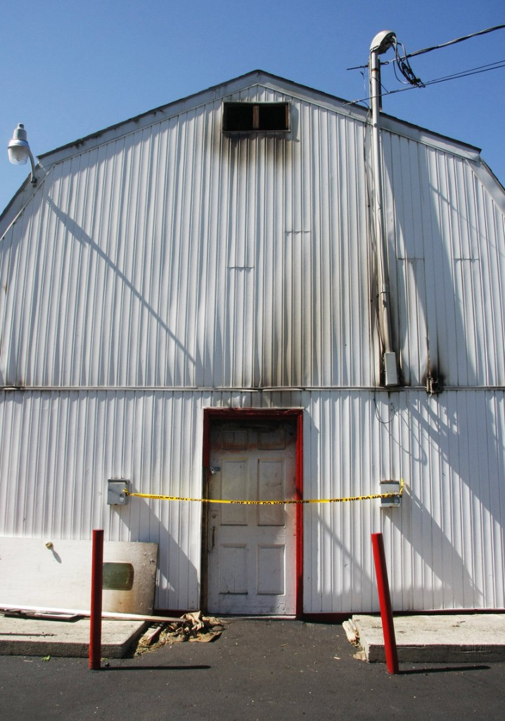 Police tape blocks access to the rear entrance of Red's Dairy Freeze. Sunday's fire charred parts of the building's exterior.
