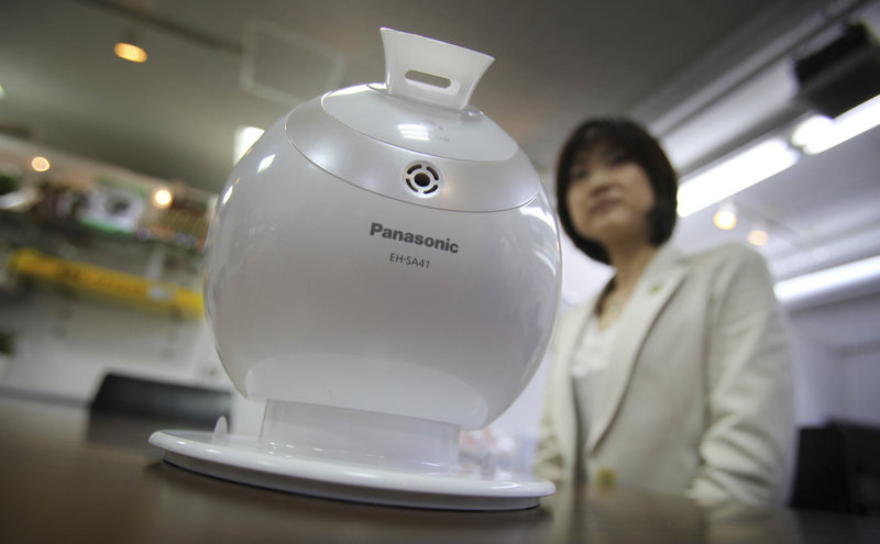 Shiori Yamada, manager of Panasonic's beauty production development team in Tokyo, shows off the Nano Care humidifier, a product she created for busy working women. Panasonic has just 2,000 women among 38,000 managers.