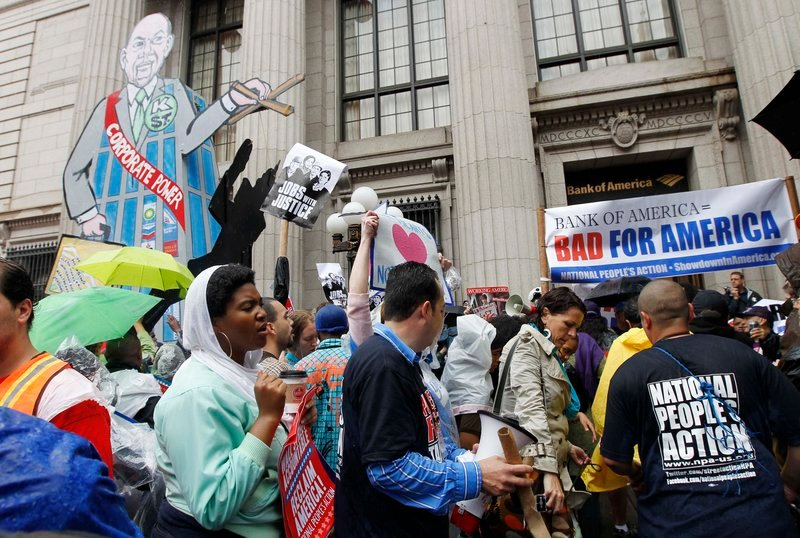 Protesters gather Monday in front of Bank of America in Washington during a rally against lobbyists representing Wall Street, corporations and anti-immigrant groups.
