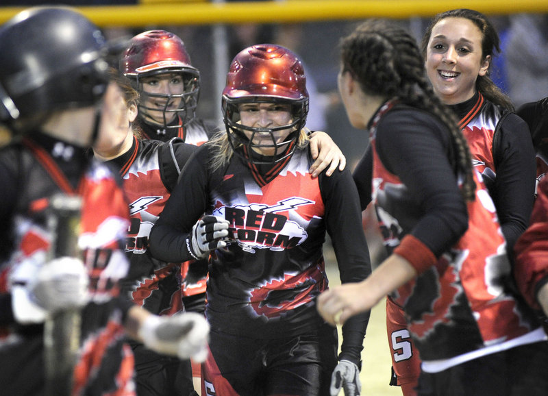 Dominique Burnham celebrates with her Scarborough teammates after hitting a grand slam in the fifth inning Monday night against South Portland. Burnham's home run capped a five-run rally that carried the defending Class A state champions to a 5-0 victory.