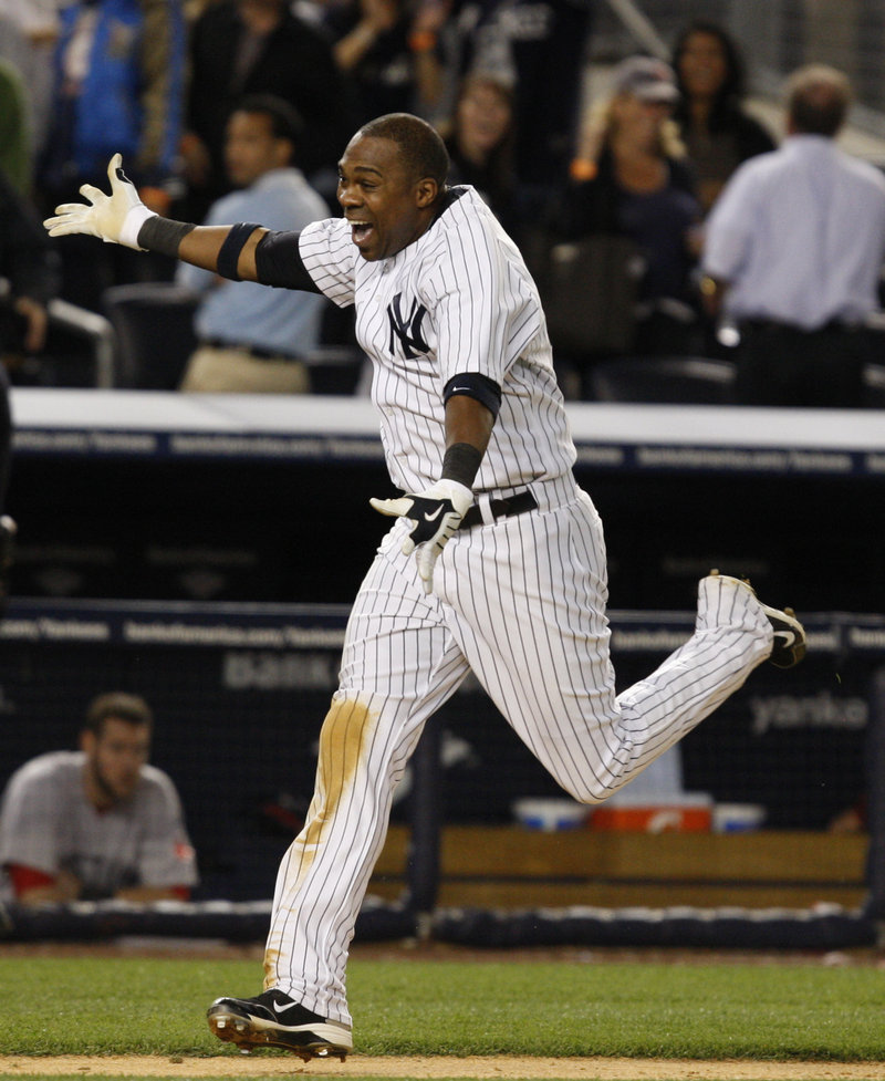 Marcus Thames heads home after hitting a winning two-run homer in the ninth inning to rally the Yankees to an 11-9 victory over the Red Sox Monday night in New York.