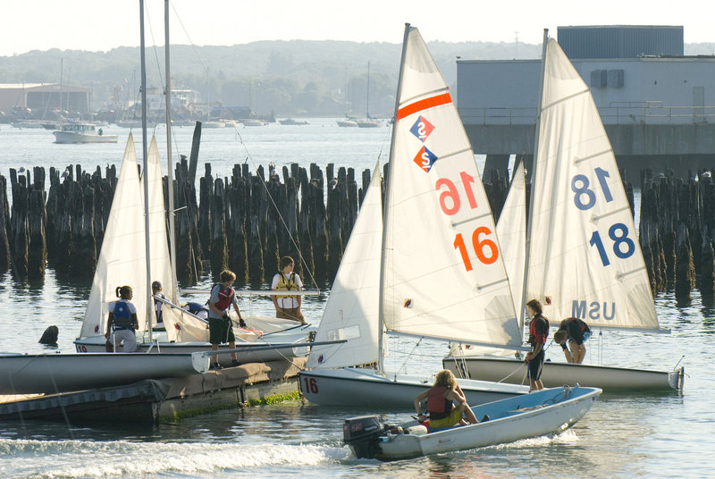 SailMaine participants from Cheverus and North Yarmouth Academy launch some boats before a competition.