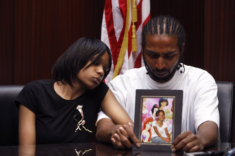 Dominika Stanley, the mother of Aiyana Jones, 7, who was killed Sunday in Detroit, sits with Aiyana's father Charles Jones in attorney Geoffrey Fieger's office in Southfield, Mich.