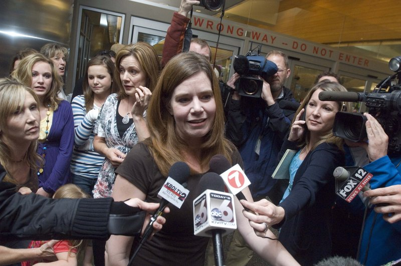 Laura Silsby, the Idaho missionary jailed for three months in Haiti, is surrounded by media after arriving in Boise Tuesday after her release. She was accused of trying to take children from Haiti after the deadly January earthquake.