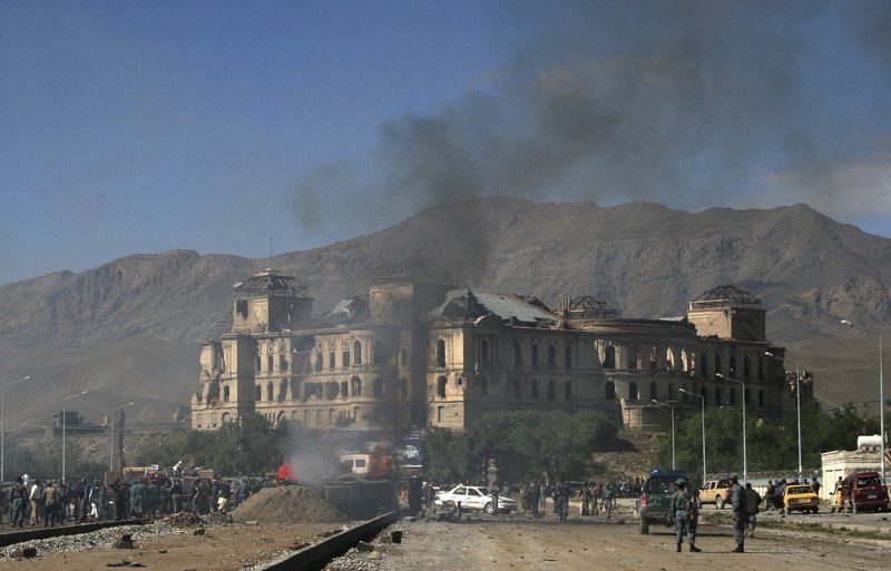 Smoke rises from the street near the Darulaman Palace in Kabul, Afghanistan, after Tuesday's suicide car bombing. The radical Islamist Taliban movement claimed responsibility for the attack, which targeted the front of a NATO convoy.