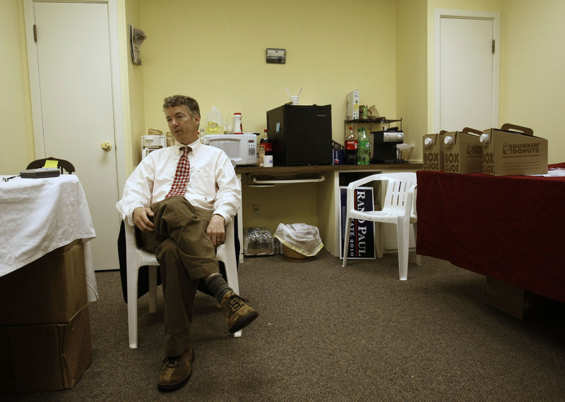 Republican U.S. Senate candidate Rand Paul sits in a makeshift kitchen at his campaign headquarters Wednesday during an interview after winning his party's primary election in Bowling Green, Ky. Paul issued a statement Thursday on the Civil Rights Act of 1964.