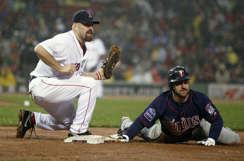 Safe or out? Well, Clay Buchholz's pickoff throw to first baseman Kevin Youkilis caught Minnesota's Nick Punto for the third out in the third inning of Boston's 3-2 win Wednesday.