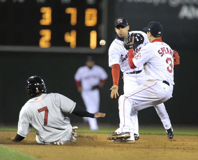 New Britain's Ben Revere slides into second base ahead of Portland shortstop Jose Iglesias' toss to second baseman Nate Spears on Wednesday night at Hadlock Field.